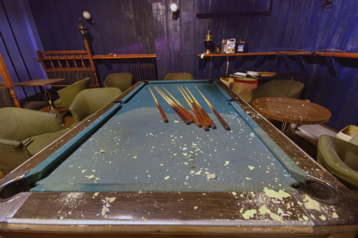 Pool table in abandoned hotel